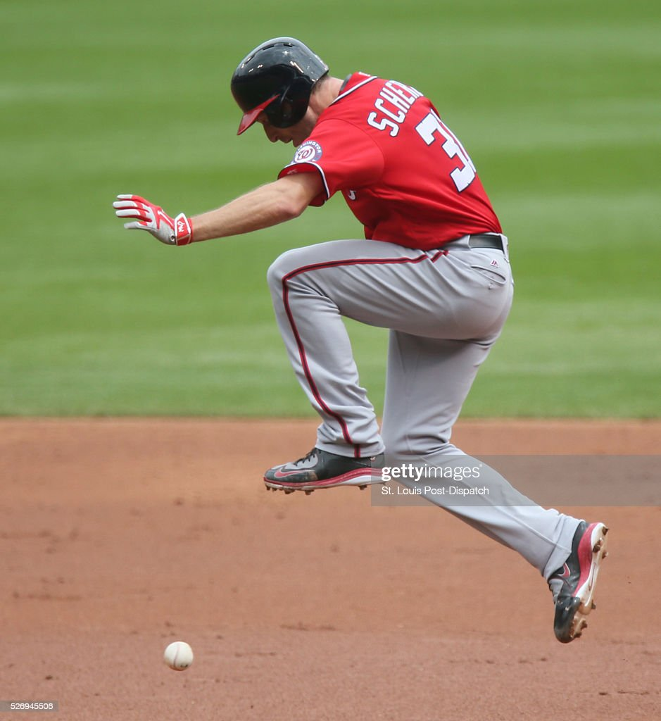 Washington Nationals' Max Scherzer jumps over a groundout by teammate Matt den Dekker as he tries to advance from first to second during the third inning on Sunday, May 1, 2016, at Busch Stadium in St. Louis.