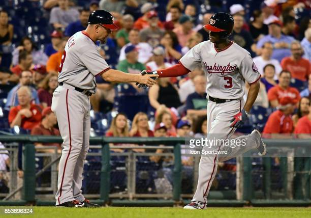 Washington Nationals Outfield Michael A Taylor shakes hands with Washington Nationals third base coach Bob Henley after hitting a home run during a...