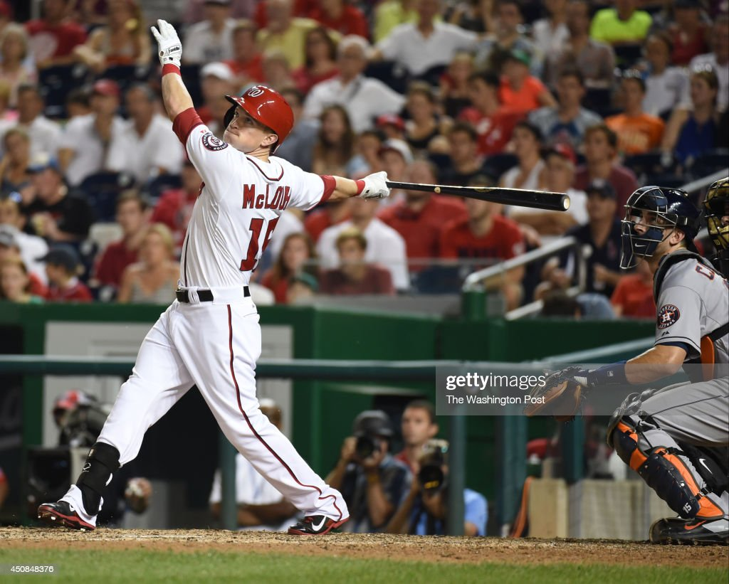 Washington Nationals pinch hitter Nate McLouth (15) sends a sac-fly to left scoring Ryan Zimmerman (11) for the game winning run over the Houston Astros on June 18, 2014 in Washington, DC.