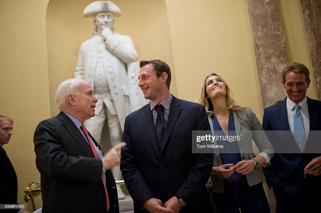 Washington Nationals pitcher Max Scherzer talks with Sen. John McCain, R_Ariz., left, in the Capitol after lunch with Sen. Jeff Flake, R-Ariz., and Scherzer's wife Erica May-Scherzer, May 24, 2016.
