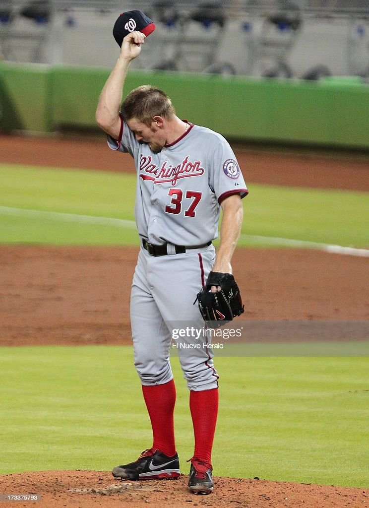 Washington Nationals pitcher Stephen Strasburg wipes his brow after the Miami Marlins' Marcell Ozuna hit a three-run triple in the first inning at Marlins Park in Miami, Florida, on Friday, July 12, 2013.