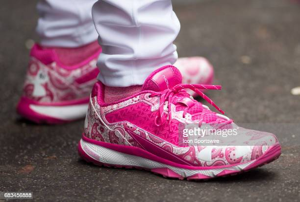 Washington Nationals pitching coach Mike Maddux sporting Breast Cancer Awareness sneakers in the Nationals dugout during a MLB National League game...