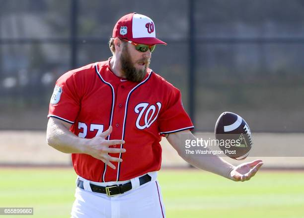 Washington Nationals relief pitcher Shawn Kelley makes a circus catch as they loosened up prior to the morning workout at the Ballpark of the Palm...
