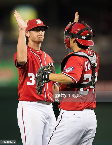 Washington Nationals relief pitcher Tyler Clippard and catcher Kurt Suzuki celebrate after their victory over the Los Angeles Dodgers following Game...
