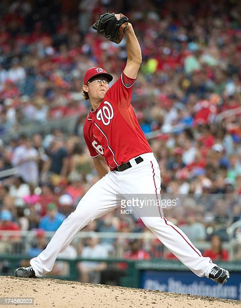 Washington Nationals relief pitcher Tyler Clippard delivers a pitch against the New York Mets during the eight inning at Nationals Park in Washington...