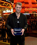 Washington Nationals right fielder and Major League Baseball 2015 National League Most Valuable Player Bryce Harper holds a ceremonial key to the...