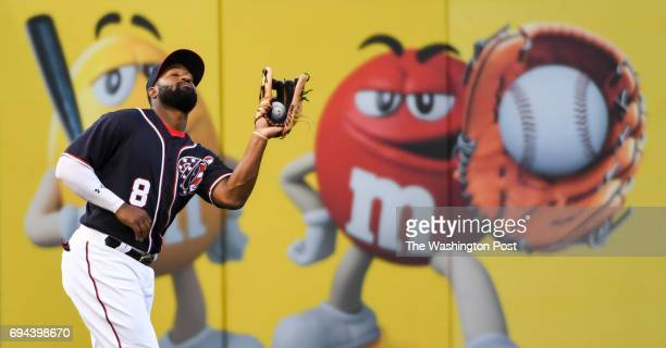 Washington Nationals right fielder Brian Goodwin makes a grab on a fly ball by Texas Rangers third baseman Joey Gallo in the second inning on June 9...