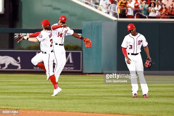 Washington Nationals right fielder Bryce Harper celebrates with center fielder Victor Robles as center fielder Michael Taylor looks on following game...