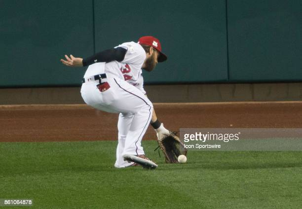 Washington Nationals right fielder Bryce Harper fields the ball during game five of the NLDS between the Washington Nationals and the Chicago Cubs on...