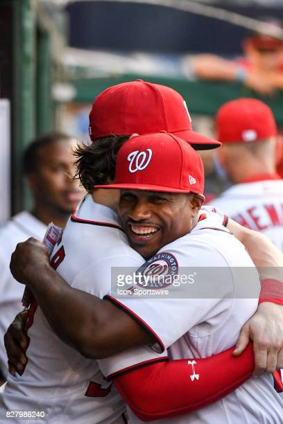 Washington Nationals right fielder Bryce Harper hugs assistant hitting coach Jacque Jones prior to an MLB game between the Miami Marlins and the...