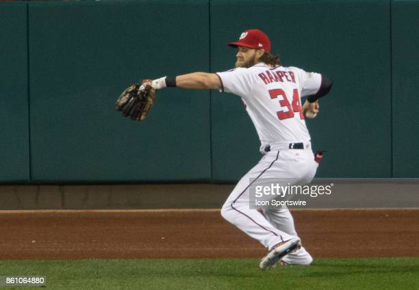 Washington Nationals right fielder Bryce Harper throws to home plate during game five of the NLDS between the Washington Nationals and the Chicago...