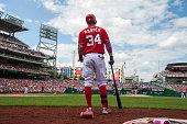 Washington Nationals right fielder Bryce Harper watches as the Atlanta Braves contest a call at second base before his at bat at Nationals Park May...