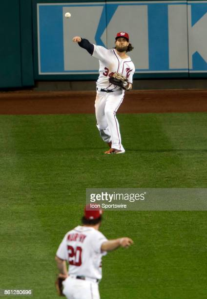 Washington Nationals second baseman Daniel Murphy directs right fielder Bryce Harper to throw to home plate during game five of the NLDS between the...