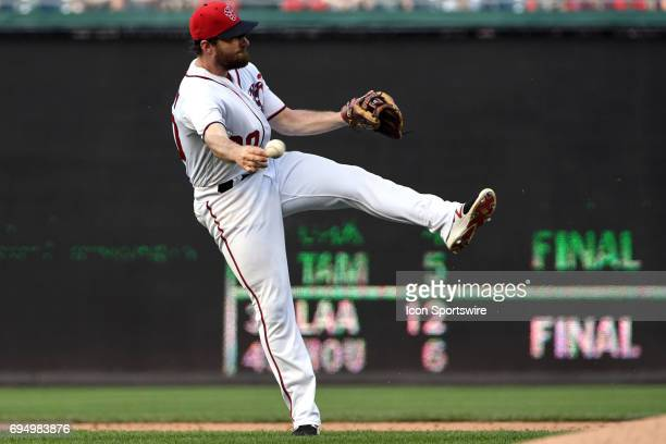 Washington Nationals second baseman Daniel Murphy fields a ground ball during an MLB game between the Texas Rangers and the Washington Nationals on...