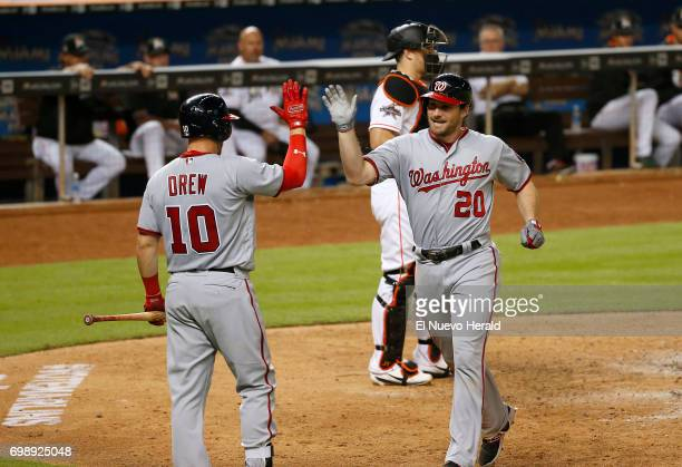 Washington Nationals second baseman Daniel Murphy is congratulated by teammate Stephen Drew after hitting a solo home run during the eighth inning...