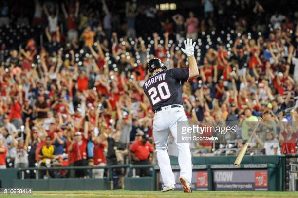 Washington Nationals second baseman Daniel Murphy tosses his bat after getting the game winning hit in the tenth inning during an MLB game between...
