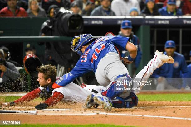 Washington Nationals shortstop Trea Turner is tagged out at home by Chicago Cubs catcher Willson Contreras in the first inning during game five of...