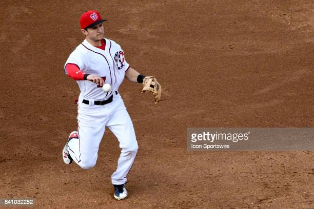 Washington Nationals shortstop Trea Turner makes a throw to first base in the sixth inning during an MLB game between the Miami Marlins and the...