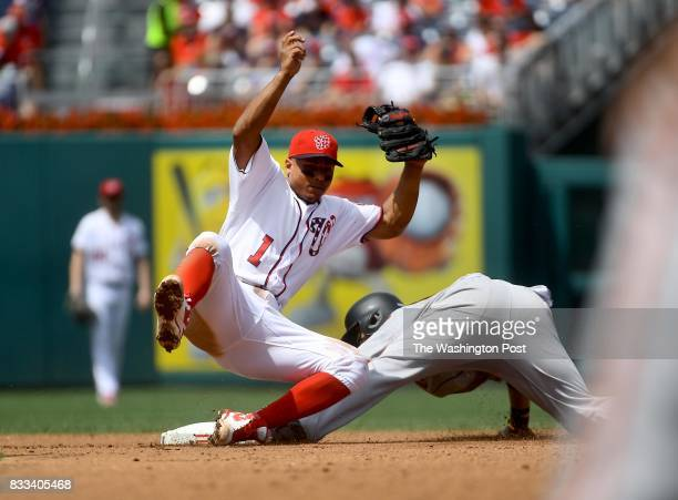 Washington Nationals shortstop Wilmer Difo cannot get the tag in time of San Francisco Giants center fielder Gorkys Hernandez in the fourth inning in...