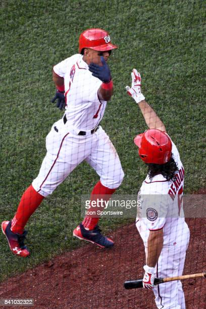 Washington Nationals shortstop Wilmer Difo is congratulated by third baseman Anthony Rendon after hitting a fifth inning solo home run during an MLB...
