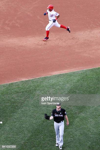 Washington Nationals shortstop Wilmer Difo rounds the bases after hitting a fifth inning solo home run against Miami Marlins starting pitcher Adam...