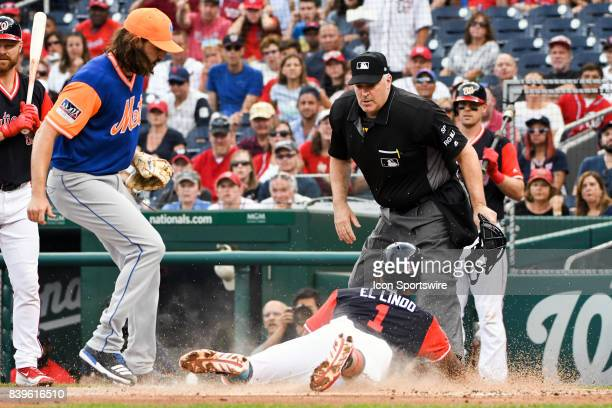 Washington Nationals shortstop Wilmer Difo scores on a wild pitch by New York Mets starting pitcher Robert Gsellman in the first inning during an MLB...