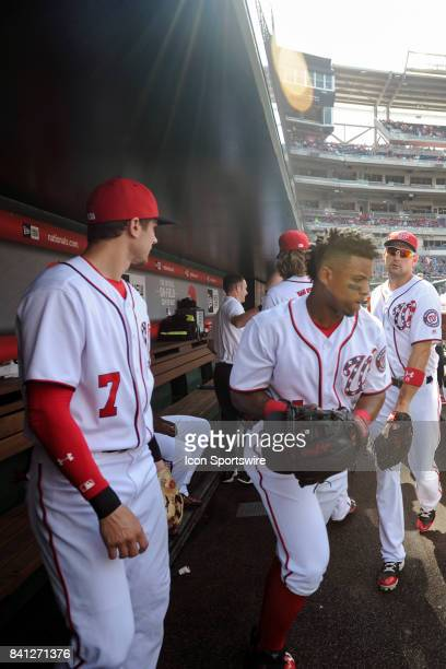 Washington Nationals shortstop Wilmer Difo shortstop Trea Turner and first baseman Ryan Zimmerman take the field for an MLB game between the Miami...