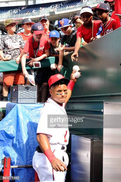 Washington Nationals shortstop Wilmer Difo signs autographs for fans prior to an MLB game between the Miami Marlins and the Washington Nationals on...