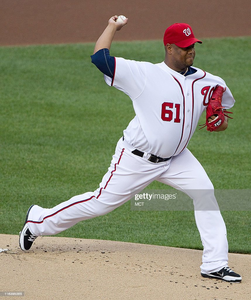 Washington Nationals starting pitcher Livan Hernandez (61) delivers a pitch against the St. Louis Cardinals during the first inning at Nationals Park in Washington, D.C, Wednesday, June 15, 2011.