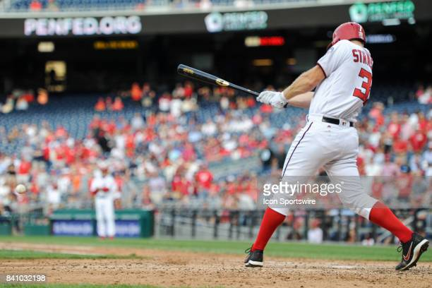 Washington Nationals starting pitcher Stephen Strasburg bats in the eighth inning during an MLB game between the Miami Marlins and the Washington...