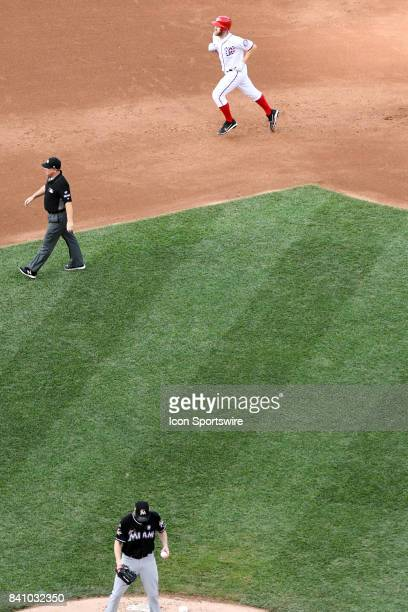 Washington Nationals starting pitcher Stephen Strasburg rounds the bases after hitting a solo home run in the fifth inning off of Miami Marlins...