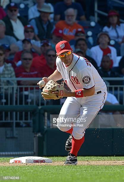 Washington Nationals third baseman Ryan Zimmerman throws out Milwaukee Brewers left fielder Ryan Braun on a hit by Milwaukee Brewers third baseman...