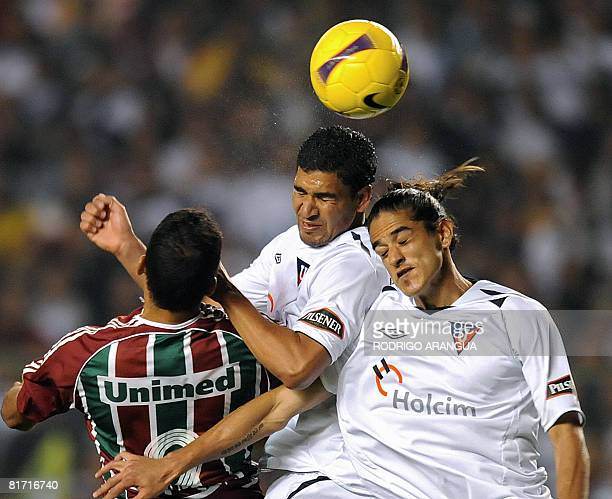 Washington of Brazil's Fluminense vies for the ball with defenders Renan Calle and Norberto Araujo of Ecuador's Liga de Quito during the first leg...