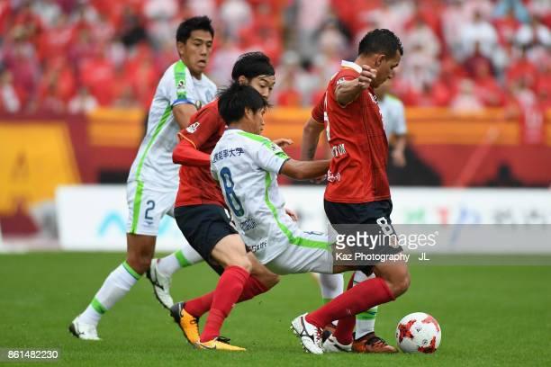Washington of Nagoya Grampus controls the ball under pressure of Naoki Yamada of Shonan Bellmare during the JLeague J2 match between Nagoya Grampus...