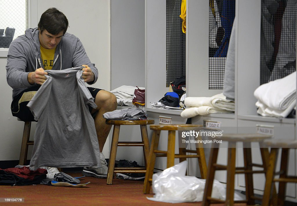 Washington outside linebacker Ryan Kerrigan folds a tee shirt as he cleans out his locker at the Redskins practice facility in Ashburn Va. This, after their season ending loss the day before to the Seattle Seahawks in the first round of the NFC playoffs.