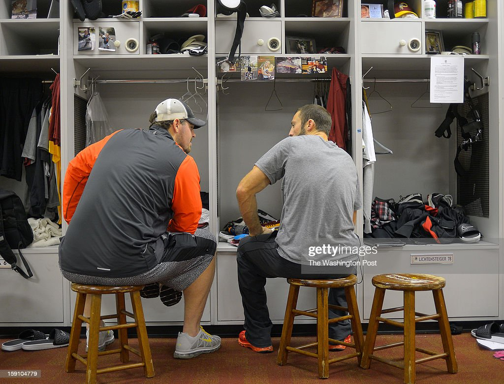 Washington players Tyler Polumbus , left, and Reed Doughty converse in front of their lockers as they pack up their belongings at the Redskins practice facility in Ashburn Va. This, after their season ending loss the day before to the Seattle Seahawks in the first round of the NFC playoffs.
