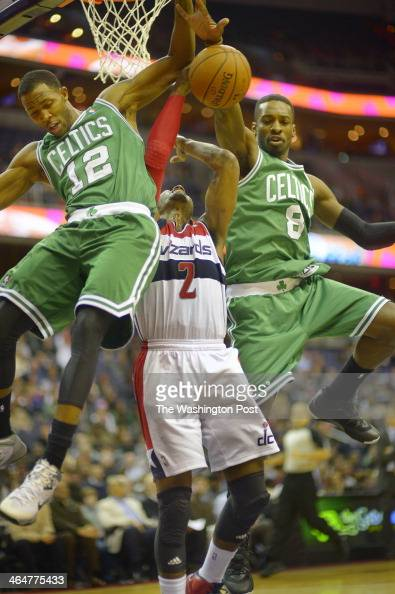 Washington point guard John Wall center has his 1st half shot blocked by Boston small forward Chris Johnson left and Boston small forward Jeff Green...