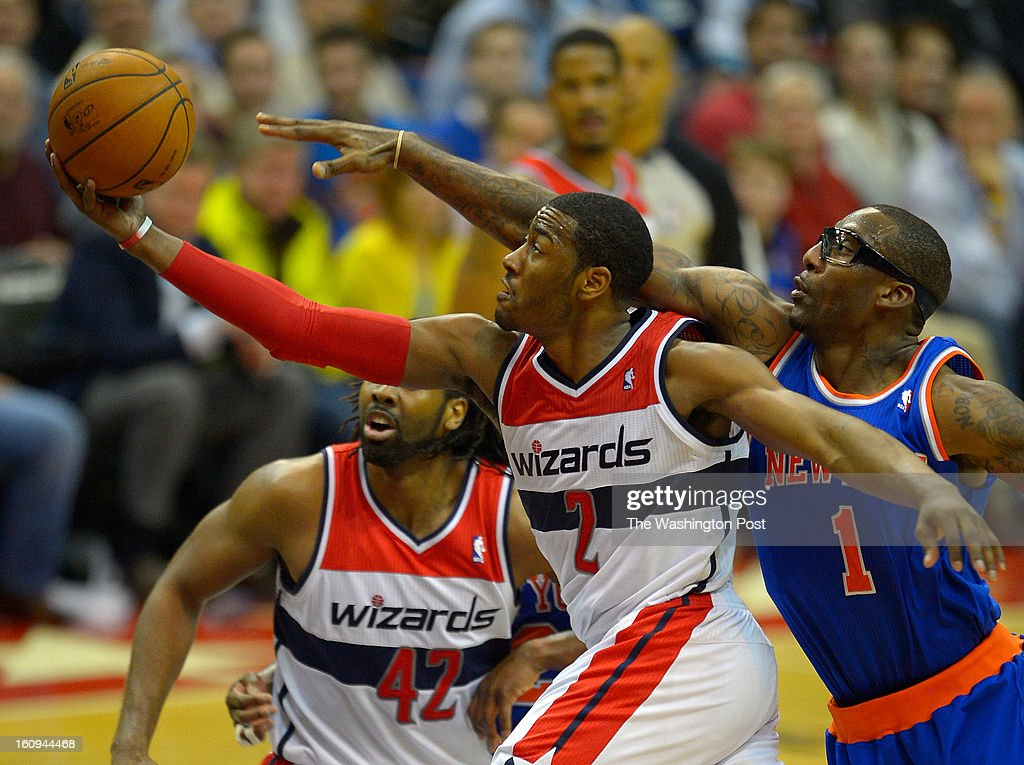Washington point guard John Wall (2), left, blows by New York power forward Amar'e Stoudemire (1) for a 2nd half drive up the lane as the Washington Wizards defeat the New York Knicks 106 - 96 at the Verizon Center in Washington DC, February 6, 2012 .