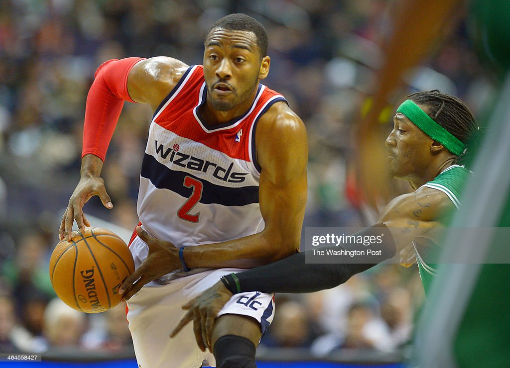 Washington point guard John Wall (2), left, has his drive to the hoop scuttled by Boston small forward Gerald Wallace (45) as the Washington Wizards host Boston Celtics at the Verizon Center in Washington DC, January 22, 2014.
