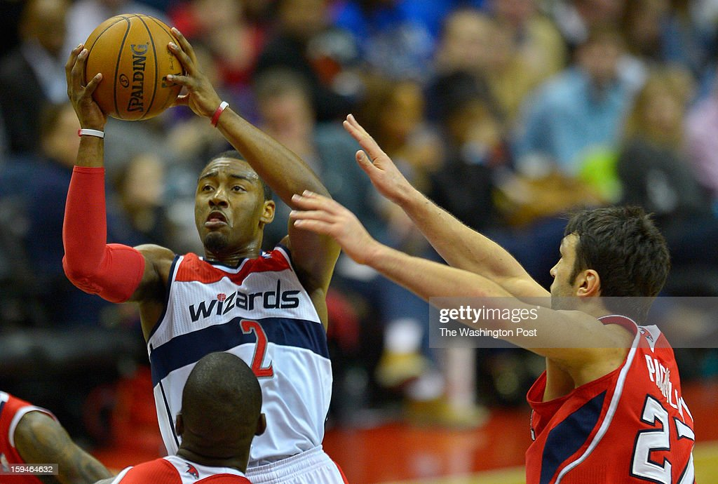 Washington point guard John Wall (2), left, rises up for a shot against Atlanta center Zaza Pachulia (27), right during the Washington Wizards defeat of the Atlanta Hawks in NBA basketball at the Verizon Center in Washington DC, January 12, 2012 .