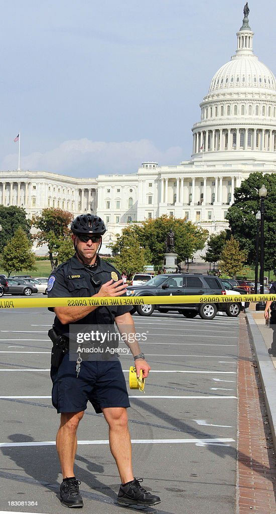 Washington police cordon off the US Capitol after shots fired were reported nearnear the Supreme Court on October 03, 2013 in Washington. Washington police have put a Senate building on lockdown after gunfire was reported near the US Capitol. Eyewitnesses said many rounds were fired at Hart Office Building, prompting the police to cordon off the area and tell people in the neighborhood to stay inside.