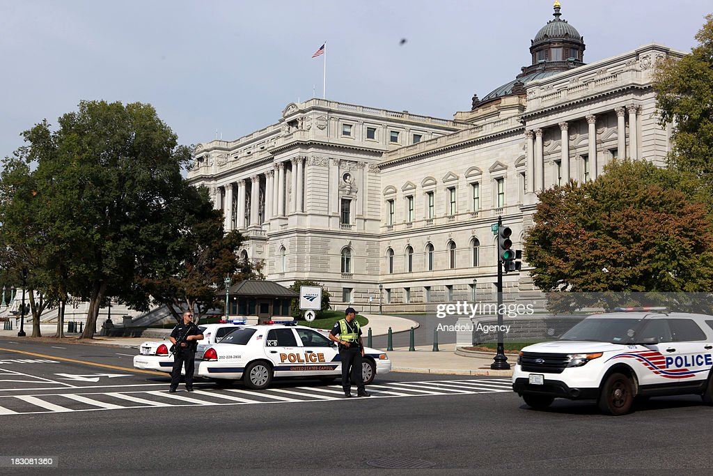 Washington police stand guard on the scene of a shooting on Constitution Avenue on Capitol Hill near the Supreme Court on October 03, 2013 in Washington. Washington police have put a Senate building on lockdown after gunfire was reported near the US Capitol. Eyewitnesses said many rounds were fired at Hart Office Building, prompting the police to cordon off the area and tell people in the neighborhood to stay inside.