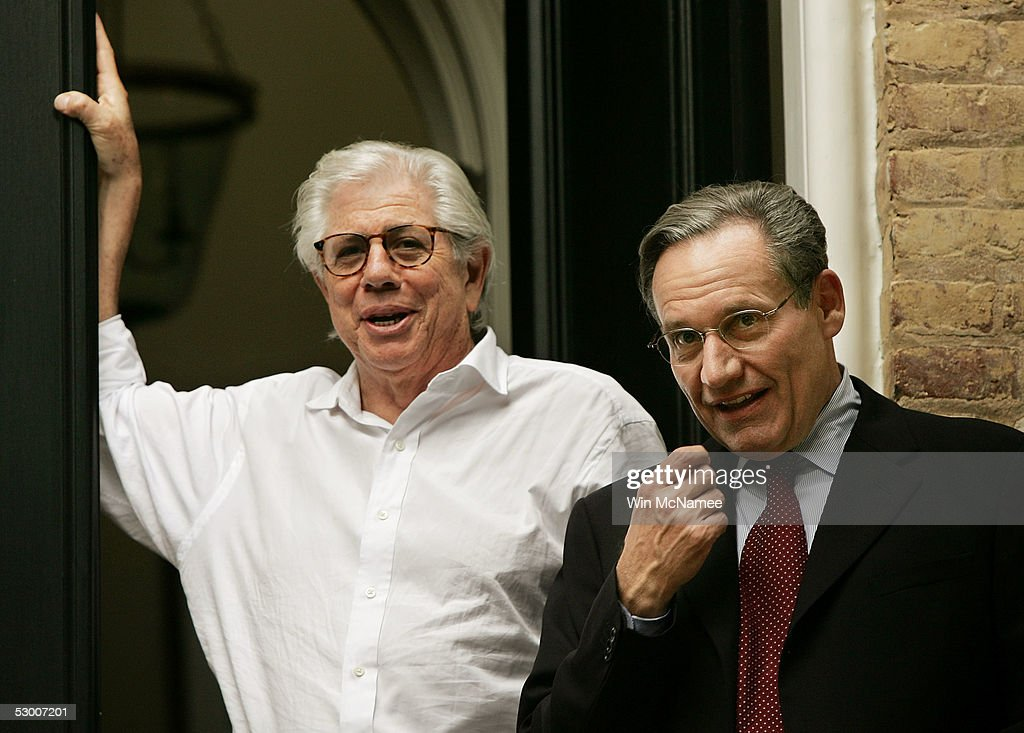 Washington Post reporters Carl Bernstein (L) and Bob Woodward speak to members of the media from the steps of Woodward's house June 1, 2005 in the Georgetown neighborhood of Washington, DC. After 30 years of secrecy Woodward and Bernstein have confirmed former FBI Deputy Director Mark Felt was the 'Deep Throat' source who helped unravel the Watergate scandal and bring down President Richard Nixon.
