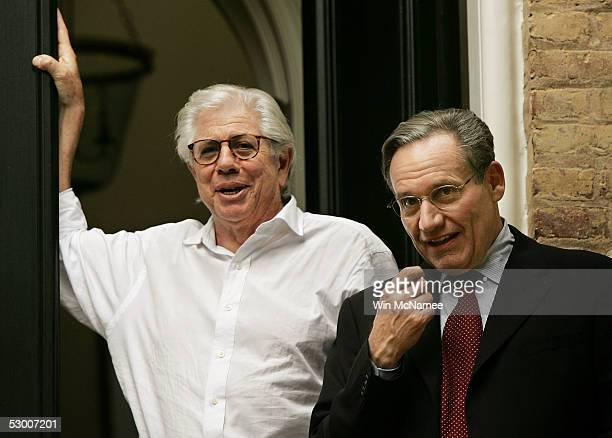 Washington Post reporters Carl Bernstein and Bob Woodward speak to members of the media from the steps of Woodward's house June 1 2005 in the...