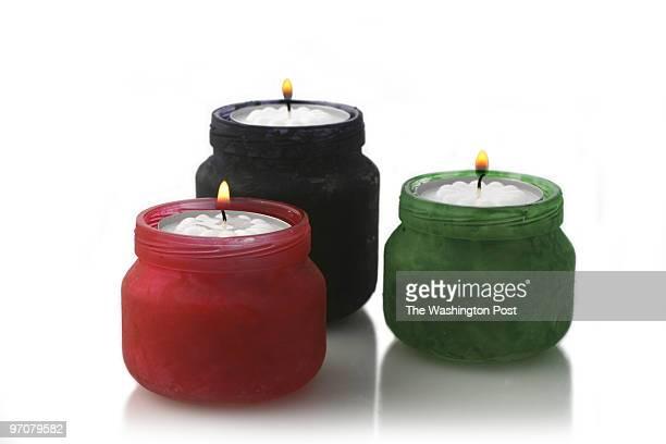 November 19 2007 PHOTO Julia Ewan/TWP Lillian S Patterson Curator Alexandria Black History Museum creates Kwanzaa candles using babyfood jars as part...
