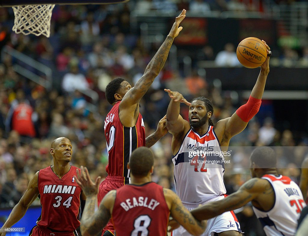 Washington power forward Nene (42) hooks a shot over Miami power forward Udonis Haslem (40) as the Washington Wizards host the Miami Heat at the Verizon Center in Washington DC, January15, 2014.