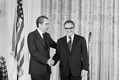 Pres Nixon congratulates Henry Kissinger after he was sworn in as secretary of state 9/22 in a ceremony in the East Room of the White House He became...