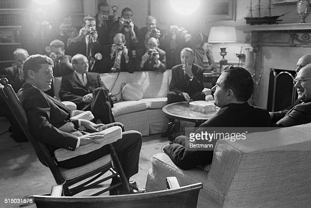 President Kennedy and Soviet Foreign Minister Andrei Gromyko pose for photographers as Gromyko calls at the White House today Seated in center on...