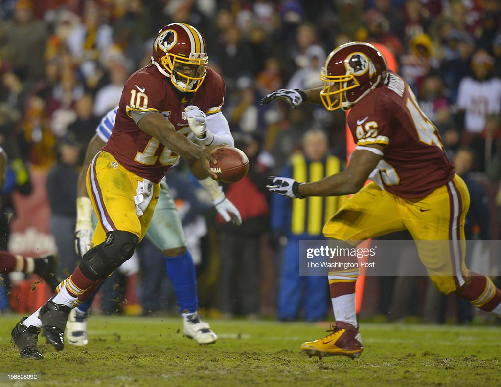 Washington quarterback Robert Griffin III (10) hands off to Washington running back Alfred Morris (46) in the third quarter as the Washington Redskins play the Dallas Cowboys for first place of the NFC East division and a playoff spot at FedEx in Landover MD, December 30, 2012 .