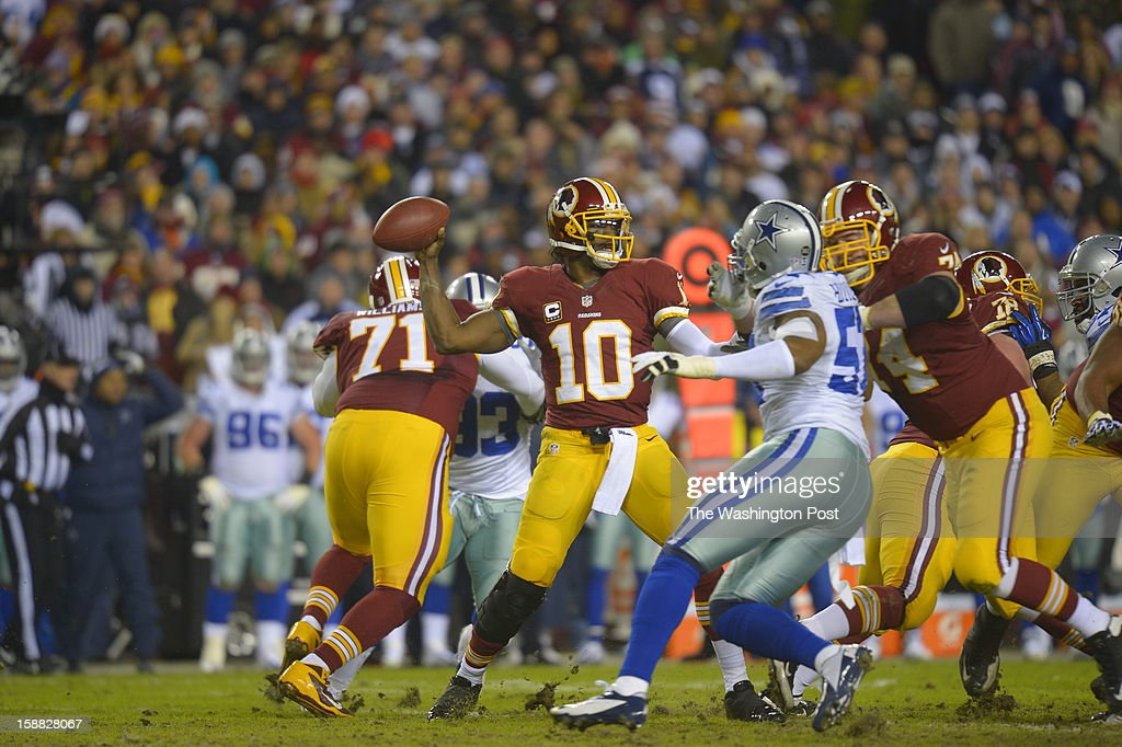 Washington quarterback Robert Griffin III (10) pass under pressure in the first quarter as the Washington Redskins play the Dallas Cowboys for first place of the NFC East division and a playoff spot at FedEx in Landover MD, December 30, 2012 .